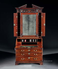 A George II Mahogany Bureau Cabinet Designed by William Kent and Attributed to William Hallett ClippedOnIssuu from Ronald Phillips - 2015