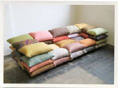 """How to make sofa out of pillows?  This cushioned sofa by Christiane Hoegner """"uses the smallest element of a sofa - the little pillow on top - as main component.  Usually used to adjust and customize your personal comfort level, it is now multiplied and piled up to the shape of a sofa"""" - very cool"""