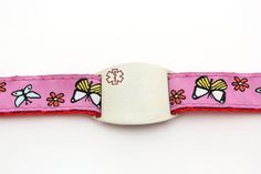 """Pretty in Pink - Children's Sports Band Bracelet - Medical ID Our new """"Pretty in Pink"""" children's sport butterfly bracelet is a great way to keep your little one safe and identified! This bracelet is extremely comfortable as it is made of nylon and polyester with an adjustable snap closure allowing it to be custom fit to your child's wrist size.  $19.95"""
