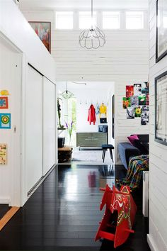 A happy Swedish home with black floors and bright colours