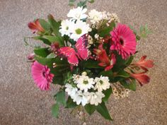 Pink gerberas, white daisies, pink alstromaria and a cute butterfly