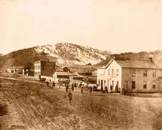 13th and Pearl Street - The oldest known photograph of Boulder, taken in 1866 from 13th and Pearl Street, looking down at the north side of the 1200 block. The Colorado House hotel is in the foreground. West of the hotel are a pig sty, a small frame building, the two-story brick Dabney-Macky block (the only brick business building in Boulder when this photo was taken), and several more frame buildings.