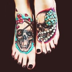 Floral skull foot tattoos