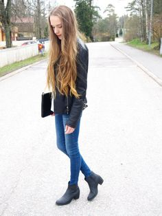 Blue denim, white top, leather jacket, booties and a clutch