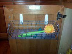 Ikea basket, 2 command hooks, under my kitchen sink- done