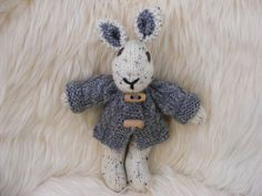 Adorable 7.5 inch hand knitted bunny / rabbit. Removable aran jacket with wooden toggles. Wooden Button Eyes  Fire Safety Approved Filling. - pinned by pin4etsy.com