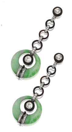 PAIR OF JADE, DIAMOND AND ENAMEL PENDANT-EARRINGS.  Designed as chains of diamond-set links and black enamel rings anchored by two larger rings of carved jade, set with 4 old European-cut diamonds weighing approximately 2.30 carats and 80 small old European-cut diamonds weighing approximately 1.00 carat, mounted in platinum. Art Deco or Art Deco style.
