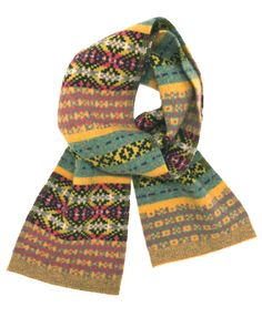 Hikaru Noguchi has created 4 exclusive scarves for Caramel this Christmas. Knitted using 100% soft lambswool and made in the UK, traditional knit patterns are complemented with a sophisticated and quirky colour palate, a truly unique look achieved through unusual juxtapositions of colour and texture. Pictured here is the fairisle pastel scarf.