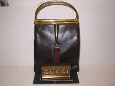 Going gah-gah over this gold-handled vintage Gucci handbag