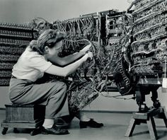 Berenice Abbott photograph of a woman wiring an early IBM computer