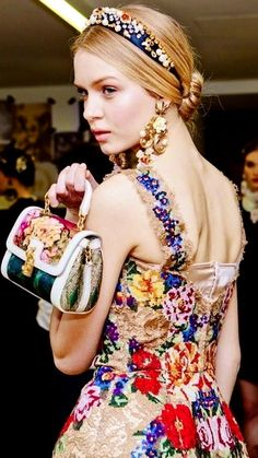 Dolce & Gabbana. I think their clothes are very elegant.. I would love to have the grace and elegance to wear them.