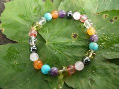 Lovely hand made charka bracelets made with real crystal beads each bracelet includes 3 set of   Rose Quartz,  Citrine Rock Quartz, Amethyst  Hematite Carnelian   Turquoise Beads