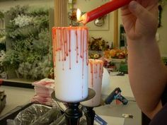 Make a pair of homemade Halloween decorations with this easy and thrifty Halloween craft project from Vicki O'Dell. Use candle wax and hot glue to create the appearance of spooky, dripping blood.