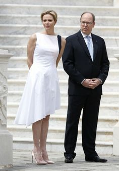 Prince's Albert II of Monaco (R) and Princess Charlene (L) take part in a welcoming ceremony as part of Montenegro's president official visit to Monaco, on May 6, 2014, in Monaco.