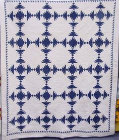 full view of blue and white quilt with sawtooth border