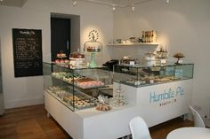 Bakery interior - an elegant way to showcase pastries at the point of sale. Retail Counter inspiration. #Retail #Decor