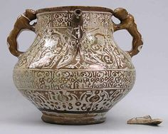 Ewer Date: late 12th–early 13th century Geography: Iran, Rayy Culture: Islamic Medium: Stonepaste; glazed and luster-painted