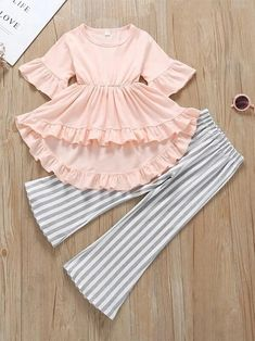 Toddler Girls Ruffle High Low Dress With Striped Flare Pants - - Toddler Girls Ruffle High Low Dress With Striped Flare Pants Ropa para niñas fashion Stylish Dresses For Girls, Little Girl Outfits, Little Girl Fashion, Toddler Girl Dresses, Kids Outfits, Girls Dresses Sewing, Toddler Girl Clothing, Kids Clothing, Baby Dresses