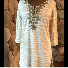 EMBELLISHED PRINT TUNIC Beige and white zebra print tunic embellished with brass studs along neckline and wrists. Slits on side. Great top! 90% cotton, 10% spandex. Size M, will fit a L! Stretches. NEVER WORN!!! Joyous & Free Tops Tunics