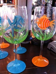 Handpainted Wine Glasses from Moonstruck Boutique. Use these on dinner tables as favors for guests, or give to the bridal party Wine Glass Crafts, Wine Craft, Cork Crafts, Wine Bottle Crafts, Bottle Art, Painted Wine Bottles, Hand Painted Wine Glasses, Wine Bottle Glasses, Wine Painting