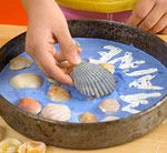 Kids' Creative Stepping-Stone  Need to do something like this to use some of those seashells that we collect every year!