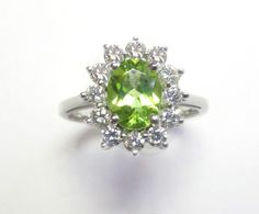 Periot & Diamond Ring - This faceted peridot is surrounded by a beautiful halo of diamonds that have a total weight of 0.75ct. The stones are set in platinum. A348-W2809X (subject to prior sale) – Lilliane's Jewelry – 4101 W. 83rd St. Prairie Village, KS 66208 – 913-383-3376 –