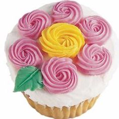 A Blooming Treat Cupcake  Another fun way to top cupcakes! Create easy flowers with swirled petals add just the right touch of color to the celebration. wilton.com