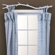 Replace your curtain rods with spray-painted branches.