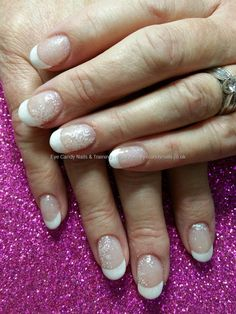 White french tips with freehand snowflakes