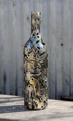 Wine Key Bottle Metal Sculpture by Moerkey on Etsy Very cool. He makes other things from keys, copper wire, pennies.Red Wine Key Bottle Metal Sculpture by Moerkey on Etsy Very cool. He makes other things from keys, copper wire, pennies. Wine Bottle Art, Wine Bottle Crafts, Diy Bottle, Bottle Vase, Beer Bottle, Bottle Opener, Wine Key, Sculpture Metal, Tree Sculpture