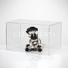 Small clear acrylic display cover for small items, to protect them from damage / dust. Designed and manufactured in the UK