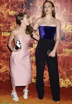 Sneaky change: Maisie opted to change into something a little more comfortable for the post-awards bash, and exchanged the fluffy towering heels she wore at the ceremony for a pair of beat-up Adidas trainers