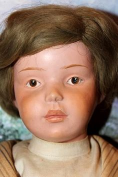 """Close-up of 16"""" wood boy doll, model number unknown, with original human hair wig, United States, 1900-20, by Schoenhut & Co."""