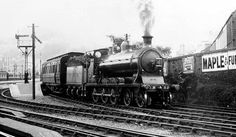No 52. A McIntosh 55 Class 4-6-0 of Caledonian Railways, built in 1905, seen here at Oban. A Stirling train leaves Oban behind no. 52, designed for this line. It became LMS 14606 on grouping and was classed by LMS as Class 4P. The engine was withdrawn in 1937, and scrapped in 1938 at KIlmarnock.