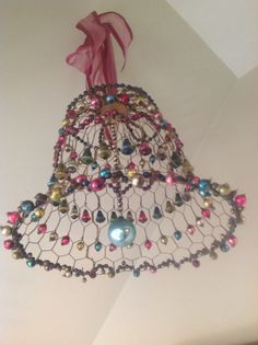vintage bell made of chicken wire and ornaments