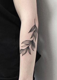 Minimalist black leaves tattoo.: