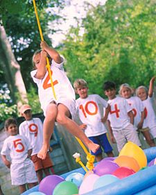 On this golden afternoon, the challenges are pure fun -- navigating a slalom course with a wagon and tiptoeing across a balance beam -- and energy. The obstacle course can be set up easily on your lawn or at a local park using items found around the house: a wooden ladder, a table, and an inflatable pool.