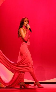 Solange Knowles Wears Custom Tina Lawson Red Jumpsuit on Late Night with Jimmy Fallon
