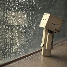 Danbo and rain Danbo, Cardboard Robot, Box Robot, Amazon Box, Rain Days, Rain Photography, Love Rain, Cute Box, Dancing In The Rain