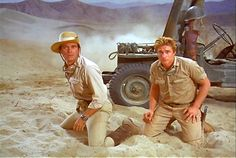 """Chris in an exciting scene with actor Justin Tarr from the TV show """"The Rat Patrol"""", 1966-68."""