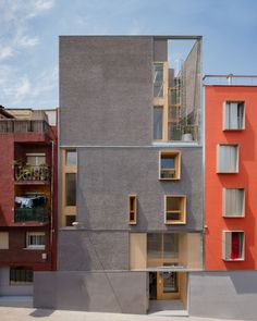 A youth centre in Spain designed by Barcelona and Madrid studio Fermín Vázquez Arquitectos uses warm colours and wooden elements to create a comforting place. Photography is by Marc Goodwin Magazine Architecture, Facade Architecture, Minimalist Architecture, Contemporary Architecture, Facade Design, Exterior Design, Photo D'architecture, B720, Modern Townhouse