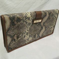 Snakeskin Clutch Jessica Simpson snakeskin clutch. In great shape! Strap is attached as well. Jessica Simpson Bags Clutches & Wristlets
