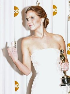 Jennifer Lawrence.~I don't know who she's flipping off, or why, but I love that she is. And the look in her face is perfect. Love her more now!