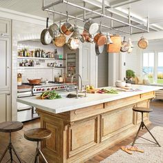 Beautiful island and clever functional cooking space around the range.