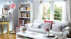 Light and bright country living room with colourful cushions