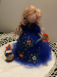 Needle felted standing doll. It can be the gift for the expectant mother. Her dress is dark blu and decoradted with flowers. She is tall about 6, but you can choose the color of her dress and dimension.