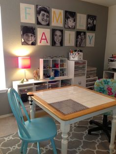 Finally have my own craft space!! Love the blue chair I spray painted. The FAMILY art was done with a stencil and used in family photos we had taken. Glad I saved them because along with the canvas pictures they make the room! The 11 x 14 prints I had done at Sams for pretty cheap and then mod podged them to canvases that I had painted black on the edges.