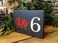 Add the perfect finishing touch to your home with a Welsh slate house sign. They're both stylish and durable! #housesign #sign #house #home #welshslate #slatesign #slate #welsh #slatehousesign #housenumber #numberplaque #handmade #handcrafted #engraved #handpainted #wales #madeinwales #bespoke #valleymill #swansea #online #designityourself #design #homeowner #finishingtouch #homeimprovements