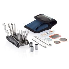 Bike repair kit. Blue pouch with reflective line on top, including 15 functions  multitool with slotted screwdriver, cross-head screwdriver,  nut driver, hex keys: 2mm, 2,5mm, 3mm, 4mm, 5mm, 6mm,  wrenches: 8mm, 10mm, 15mm, spoke wrench: 14GE, sockets:  8mm, 9mm, 10mm, set with black plastic rack, 2 nickel plated  crowbar, tube glue, grinder and 3 rubber.