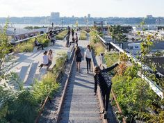 New York celebrates the opening of the High Line at the Rail Yards, the final section of the city's elevated park, running through the Lower West Side: